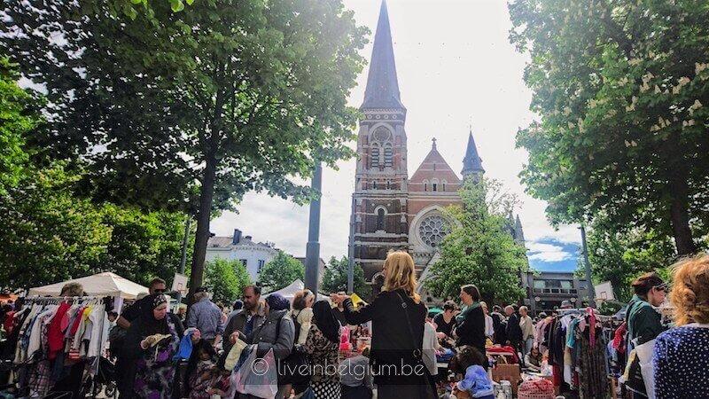 Sint-Norbertuskerk Church behind Rommelmarkt Dageraadplaats Jumbo Sales Flea Market in Antwerp Zurenborg